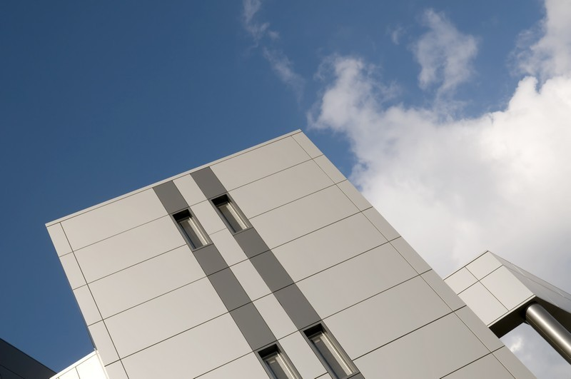 Abstract architecture detail over blue sky with clouds