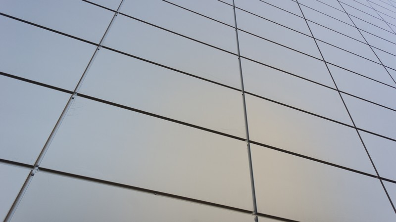 Grey metal perspective wall of business center
